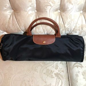 24678aea67 Longchamp Bags - Longchamp le pliage foldable carry on suitcase